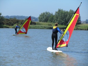 Students on a start windsurfing course at rye water sports