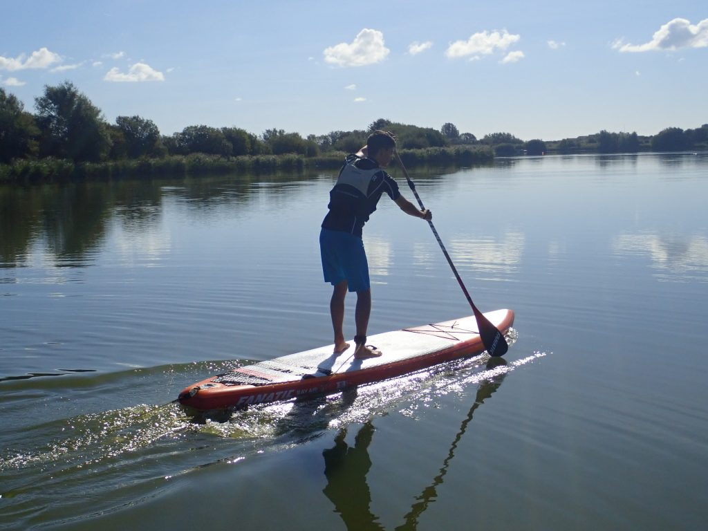 stand up paddle boarding on calm waters at rye watersports