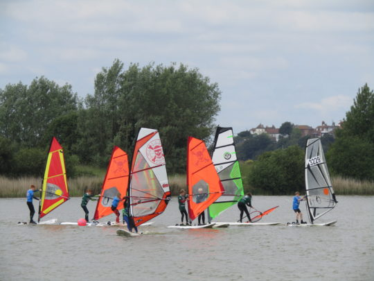 kids learning to windsurf