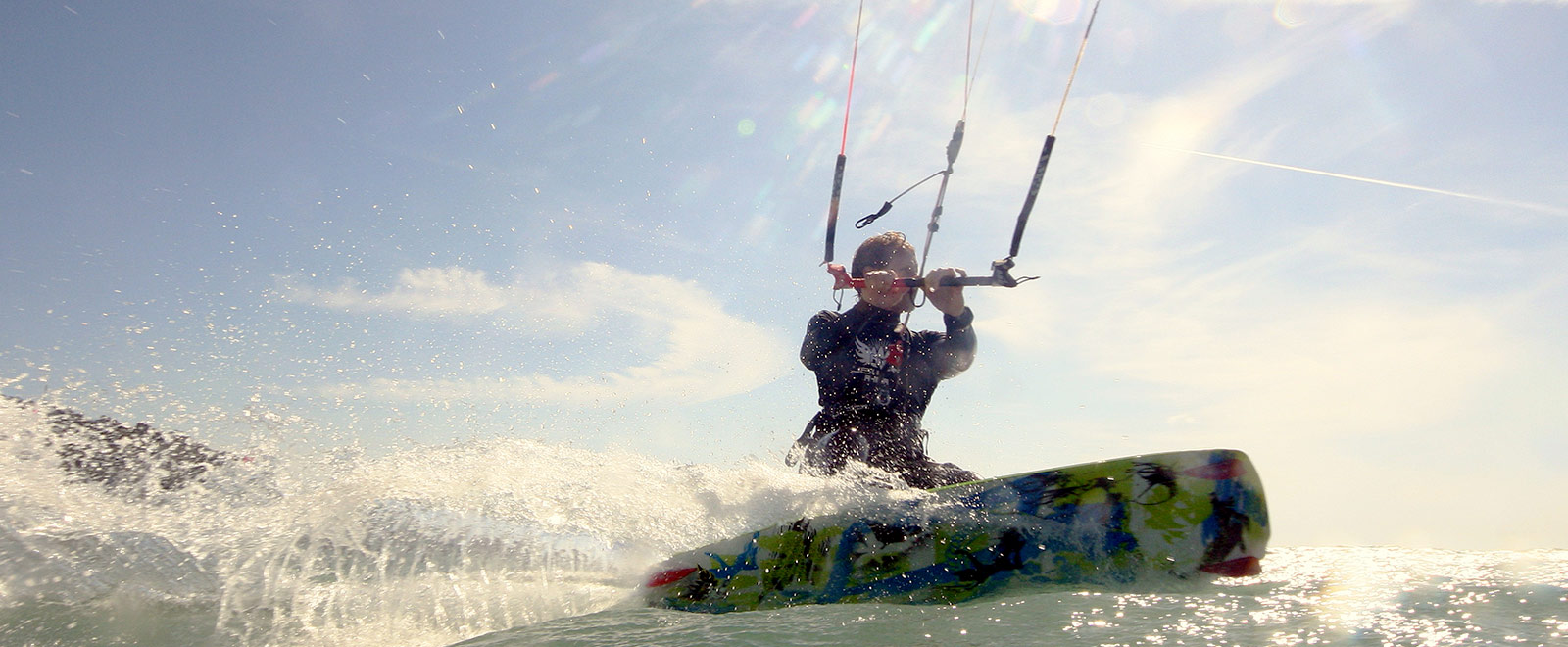 kitesurfer sunlight waterspray camber sands
