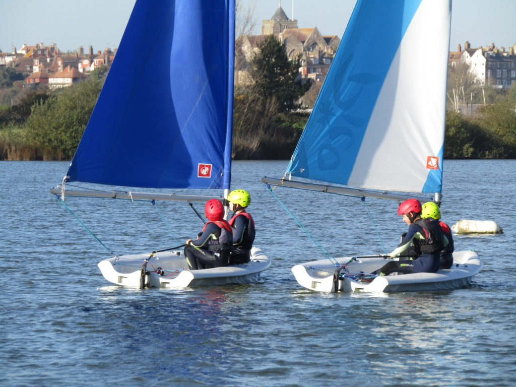 kids dinghy sailing with rye in the background