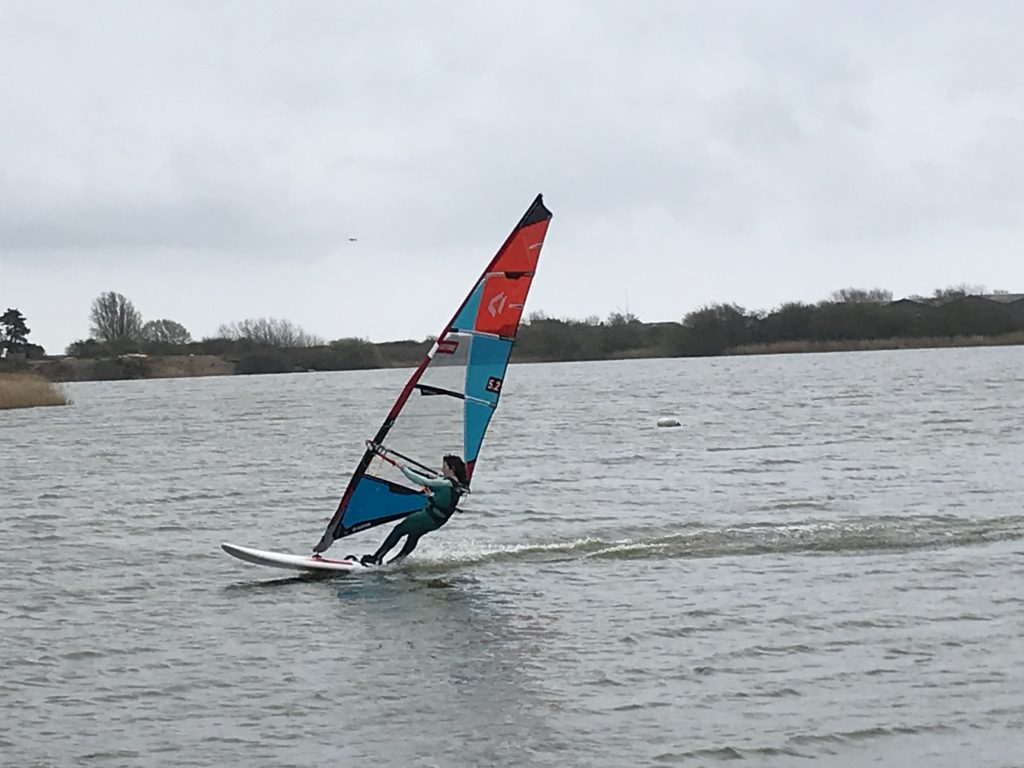 teenager blasting on lake at rye watersports